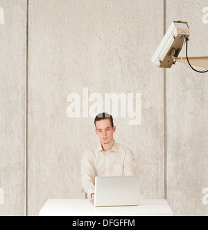 Conceptual image of internet privacy and computer surveillance, man being watched - Stock Photo