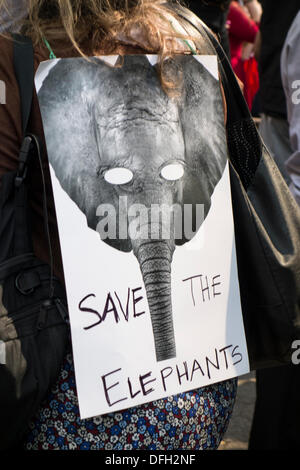New York, NY, USA. 4th Oct. 2013. Supporters of iWorry march in a campaign to stop the killing of elephants for - Stock Photo