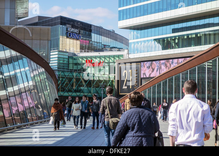 Westfield Stratford City Shopping Centre and Aspers Casino Westfield Stratford City Shoppers crossing the link bridge. - Stock Photo