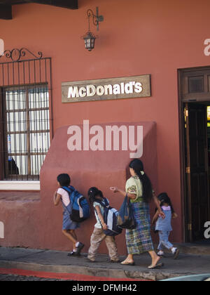 A McDonalds restaurant confronts the colonial architecture of Antigua, Guatemala - Stock Photo