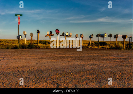 An editorial style image of rural mailboxes along old route 66,near Holbrook Arizona - Stock Photo