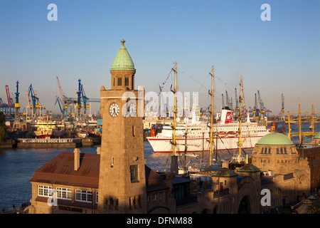 Cruise ship MS Deutschland entering port at the tower of St. Pauli Landungsbruecken, Hamburg, Germany, Europe - Stock Photo