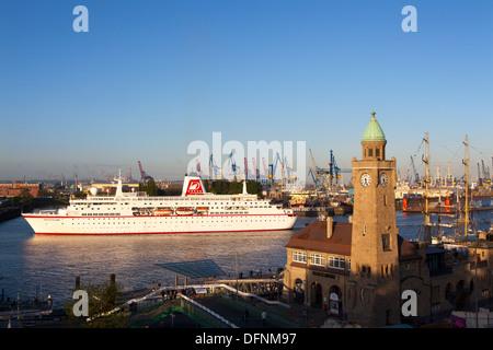 Cruise ship MS Deutschland entering port at the tower of St. Pauli Landungsbruecken, Hamburg, Germany, Europe - Stock Photo