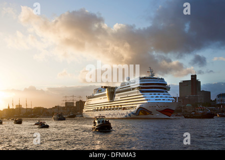 Cruise ship AIDAsol entering port in the evening light, Hamburg, Germany, Europe - Stock Photo