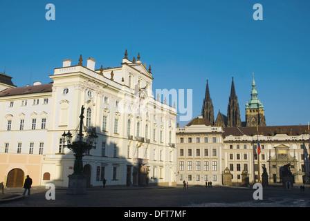 Arcibiskupsky palac and Prazsky hrad the castle at Hradcanske namesti square in Hradcany district of Prague Czech - Stock Photo