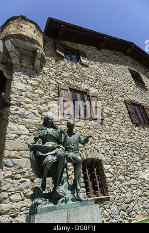 Andorra - capital city Andorra la Vella. Adminsitrative buildings. Statue representing youth of Andorra and traditions. - Stock Photo
