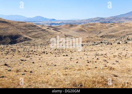 panorama of stone plateau of Zorats Karer (Carahunge) - pre-history megalithic monument in Armenia - Stock Photo