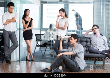 Office workers in deep thought - Stock Photo