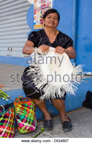 Woman making ´Panama Hat´ in Montecristi colonial town, Greater Manta area, Ecuador, South America - Stock Photo