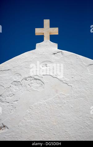 Orthodox Cross on the roof of the Agios Ioanis Prodromos Church, Ano Mera, Pano Meria Village, Folegandros, Cyclades - Stock Photo
