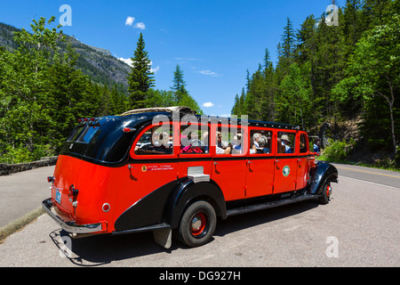 Red Bus Tour in the parking area of McDonald Falls, Glacier National Park, Montana, USA - Stock Photo