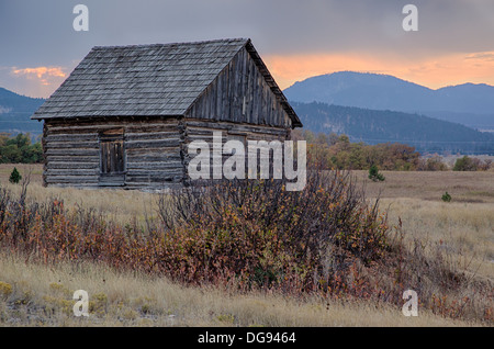 One room school house on the prairie in South Dakota at sunset - Stock Photo