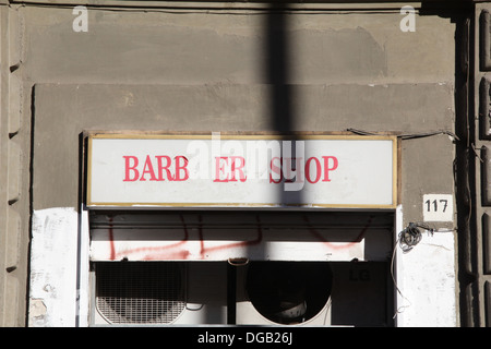 barber shop sign notice in rome italy - Stock Photo