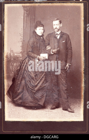 Old portrait of marriage. Vintage. Aged copy. 1890s. Studio portrait. The sepia toning. - Stock Photo