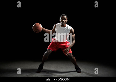Male basketball preparing to throw - Stock Photo