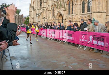 York, UK. 20th Oct, 2013. Elite Kenyan athletes John Mutai and John Kales run past York Minster in the first Plusnet - Stock Photo