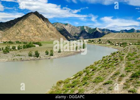 Siberian village on the banks of Katun River, Altai Republic, Siberia, Russia, Asia - Stock Photo