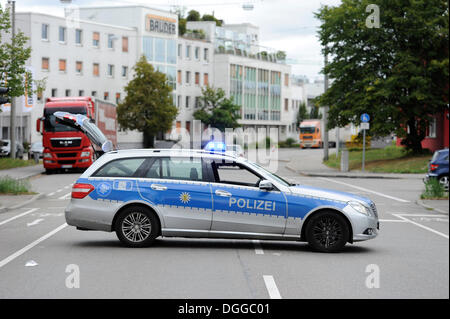 Police car blocking a road, Stuttgart, Baden-Wuerttemberg - Stock Photo