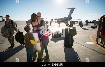 U.S. Air Force 1st Lt. Steven Draughon, 366th Aircraft Maintenance Squadron, reunites with his family at Mountain - Stock Photo