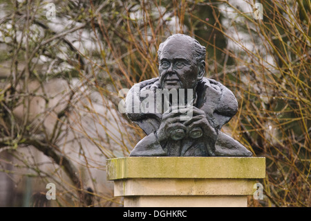 Bust of Sir Peter Scott wet from rain naturalist and founder of Wildfowl and Wetlands Trust Slimbridge Gloucestershire - Stock Photo