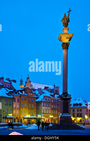 Winter twilight in Castle Square in Warsaw with Zygmunt's Column on the right. - Stock Photo