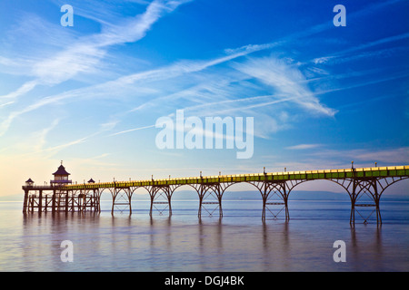 Evening light falls on the pier at Clevedon. - Stock Photo
