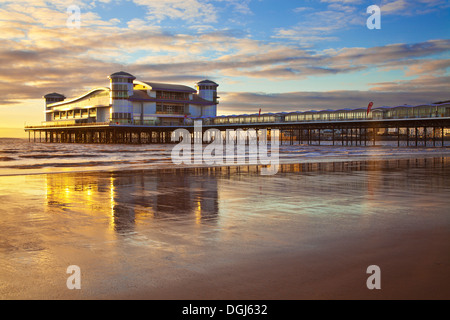 Golden evening light falls on the Grand Pier at Weston Super Mare. - Stock Photo
