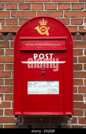 Red letter box of the Danish postal service Post Danmark, Nysted, Denmark, Europe - Stock Photo