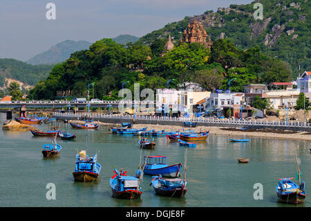 Fishing boats, Port of Nha Trang on the Cai river, in the back the Po Nagar temple, Vietnam, Southeast Asia - Stock Photo