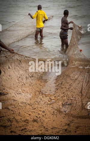 Fishermen on the shores of Lake Victoria in Entebbe, Uganda, East Africa. - Stock Photo
