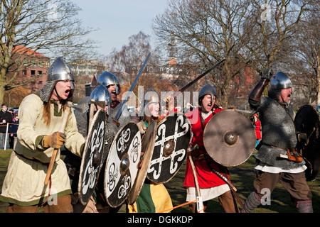 A skirmish reenactment between Vikings and Anglo Saxons at the Viking Festival. - Stock Photo