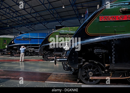 A man photographing one of the A4 Pacific steam locomotives at the National Railway Museum. - Stock Photo