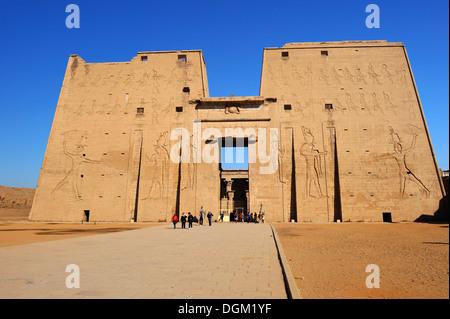 Entrance Pylon of Temple of Horus at Edfu, Upper Egypt - Stock Photo