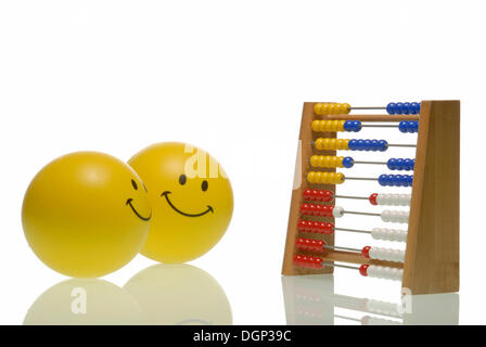 A smiley coaching another with an abacus, symbolic image for coaching - Stock Photo