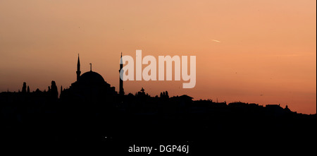 Istanbul, Turkey, the silhouette of the Fatih Mosque at sunset - Stock Photo