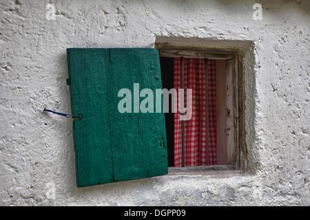 Window with a wooden shutter, Hoerlalm near Hochfilzen, Tyrol, Austria, Europe - Stock Photo