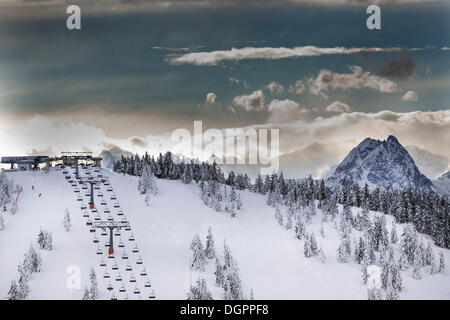 Chair lift on Eiberg Mountain in the Wilder Kaiser Ski World, summit of Grosse Rettenstein Mountain, 2366m, on the - Stock Photo