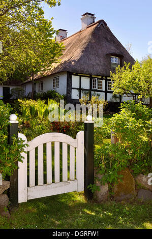 Half-timbered house behind a garden gate, Sieseby on the Schlei river, Thumby, Rendsburg-Eckernfoerde district - Stock Photo