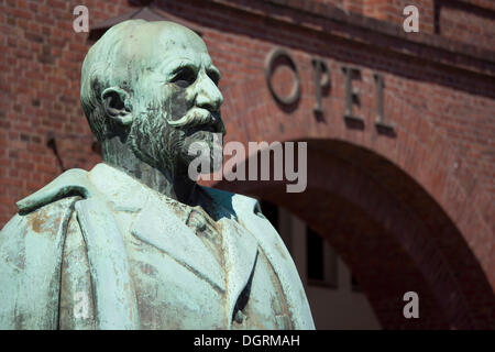 Statue of Adam Opel in front of the old portal of the Opel plant in Ruesselsheim, Hesse - Stock Photo