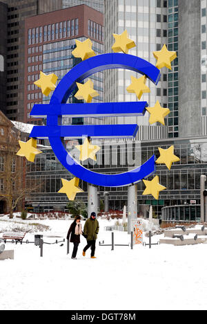 Euro sculpture, symbol of the European currency, European Central Bank, ECB, snowy Willy-Brandt-Platz square, Frankfurt - Stock Photo