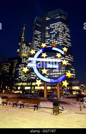 Euro sculpture, symbol of the European currency, ECB, European Central Bank in the evening, snowy Willy-Brandt-Platz - Stock Photo