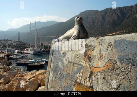 Seal, sculpture, wall painting in the port of Kas, Lycian coast, Antalya Province, Mediterranean, Turkey, Eurasia - Stock Photo