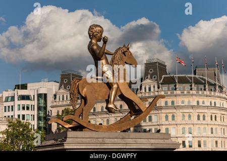 Bronze boy on a rocking horse by Elmgreen & Dragset, Trafalgar Square, London, England, United Kingdom, Europe - Stock Photo