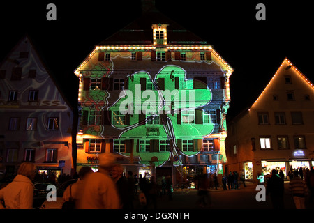 Clover image projected on Kleeblatthaus building, market square, of Biberach an der Riss, light projection installation - Stock Photo