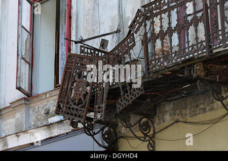 Decaying balcony in the Strada Franceza, Bucharest, Romania, Europe - Stock Photo