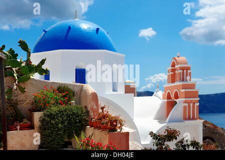 Blue domed Byzantine Orthodox church, Oia, Ia, Santorini, Cyclades Islands, Greece, Europe - Stock Photo