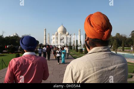 Sikh tourists in front of the Taj Mahal, Agra, Uttar Pradesh, India, Asia - Stock Photo