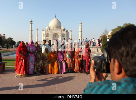 Indian tourists pose for a photo in front of the Taj Mahal, Agra, Uttar Pradesh, India, Asia - Stock Photo