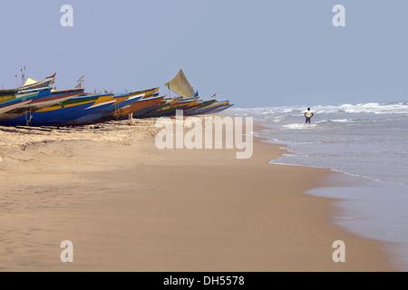 Boats on beach in Orissa, Puri, Orissa, India - Stock Photo
