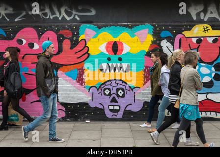 Graffiti street art in Shoreditch, East End, London, England, UK - Stock Photo